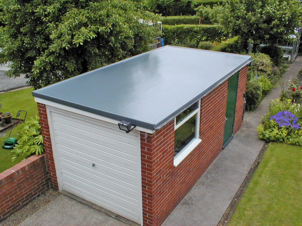 Flat roof repairs garage roof repairs free estimates for Garage roofing options