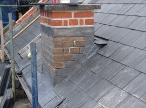 Leadwork Roofing Contractor installing Lead stepped flashing and lead front apron being Installed Roofers In Edinburgh